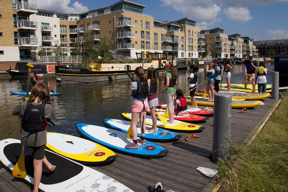 paddle boarders on pontoon