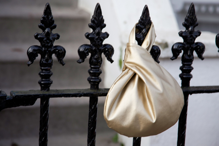 gold bag on the railings