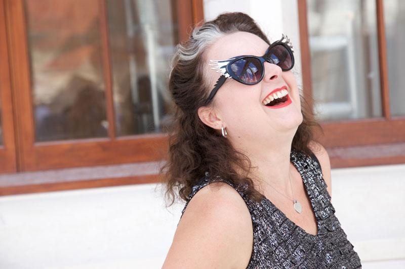 wearing burda silver dress laughing