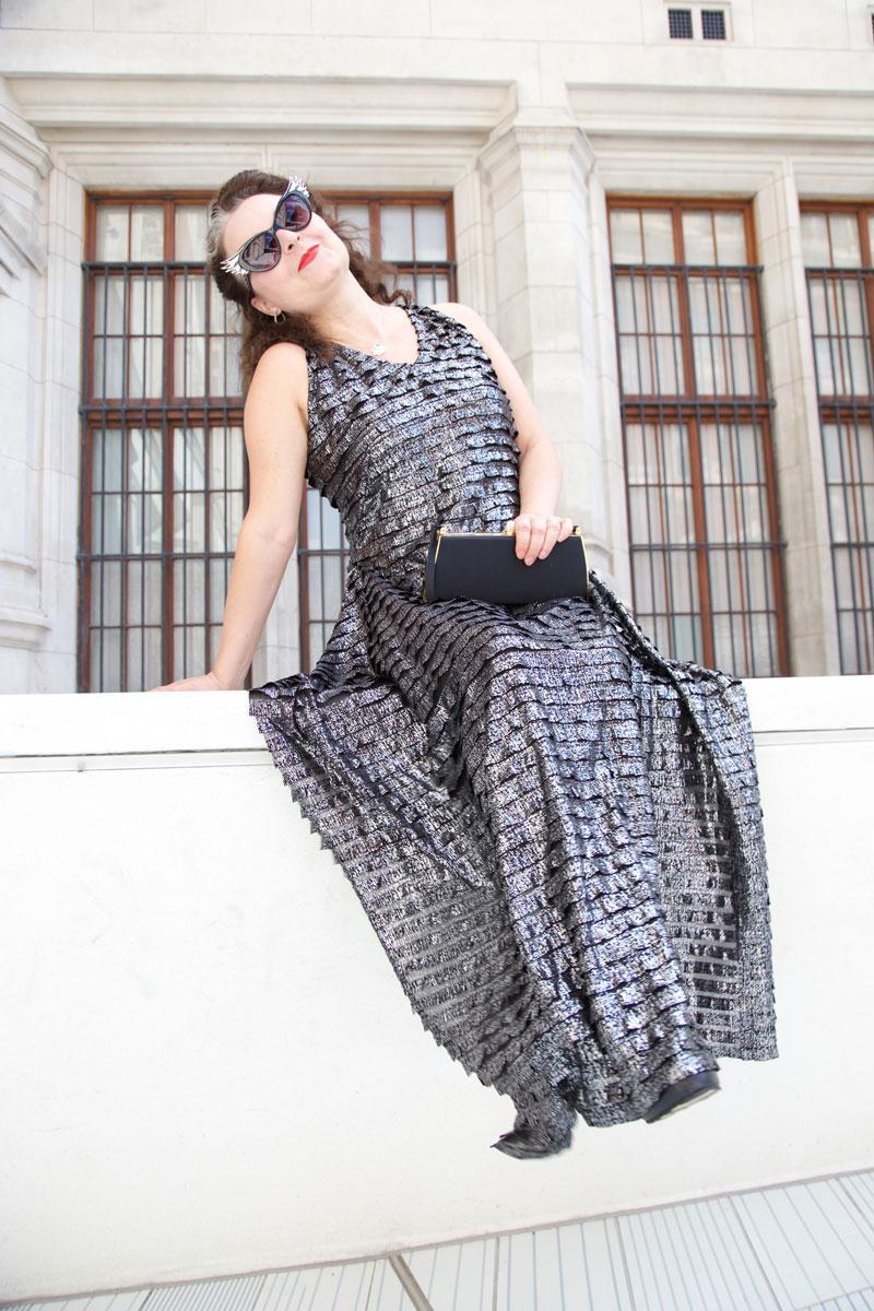 Metal burda dress sitting on a wall