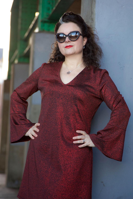 red glittery bell sleeve dress