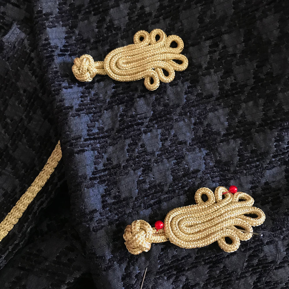 gold frog fastenings