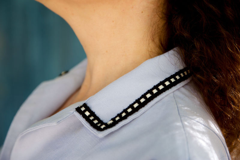 ribbon-insert trim on collar