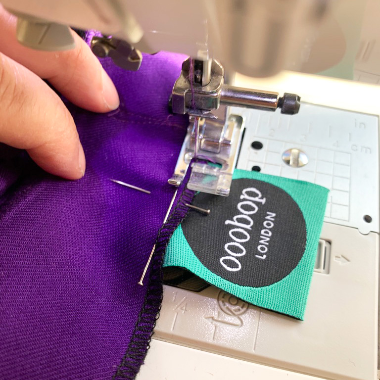 ooobop label being sewn into the garment